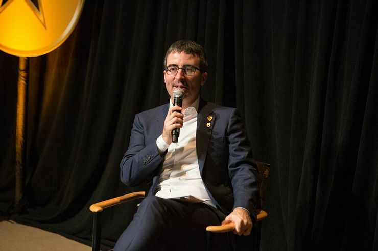 John Oliver interviewing a veteran on stage during the second annual Got Your 6 Storytellers event at HBO in NYC