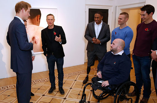 Prince Harry and Bryan Adams at the Wounded: The Legacy of War photographic exhibition
