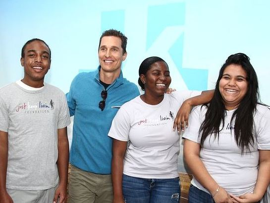 Matthew McConaughey and some kids from his Foundation