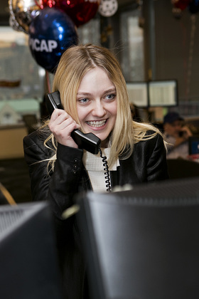 Dakota Fanning answers the phones on the trading floor at ICAP's North American headquarters in Jersey City, NJ