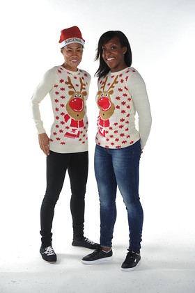 Rachel Yankey and Danielle Carter Model Save the Children Christmas Jumpers