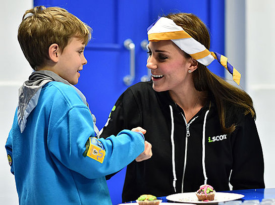 The Duchess of Cambridge dons a blindfold during a session to teach children what it is like to live with a disability