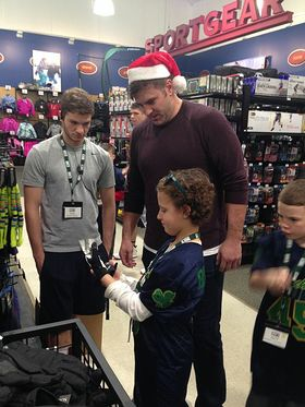 Todd Herremans with kids at DICK'S Sporting Goods