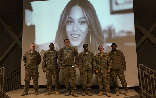 Troops stationed at Bagram Airfield in Afghanistan pose for a photo on New Year's Eve