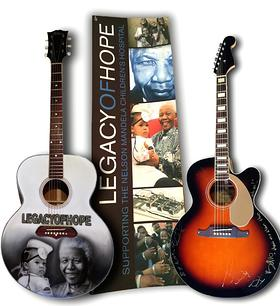 U2 signed guitar alongside trademark Legacy of Hope Campaign Guitar
