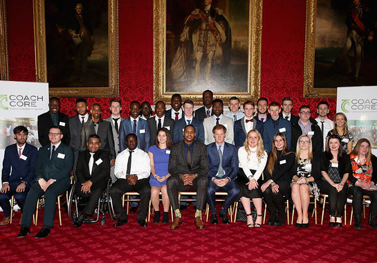 Prince Harry and NBA All-Star Carmelo Anthony have a group photograph with Coach Core apprentices at the Coach Core Graduation at St James's Palace.