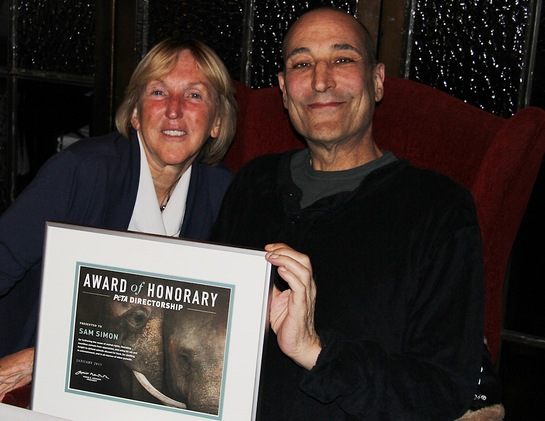 PETA President Ingrid E. Newkirk presenting Sam Simon with a certificate