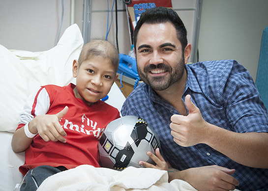 Enrique Santos shares his love with St. Jude patient Anderson
