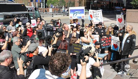 Sam Simon speaks to protesters in Los Angeles at World Love for Dolphins Day 2015