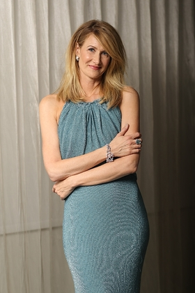 Laura Dern continues the Oscars celebration by slipping into a turquoise Badgley Mischka dress for the Vanity Fair After-Party