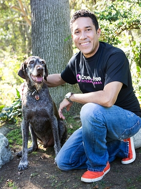 Oscar Nunez, with his rescue dog Gus