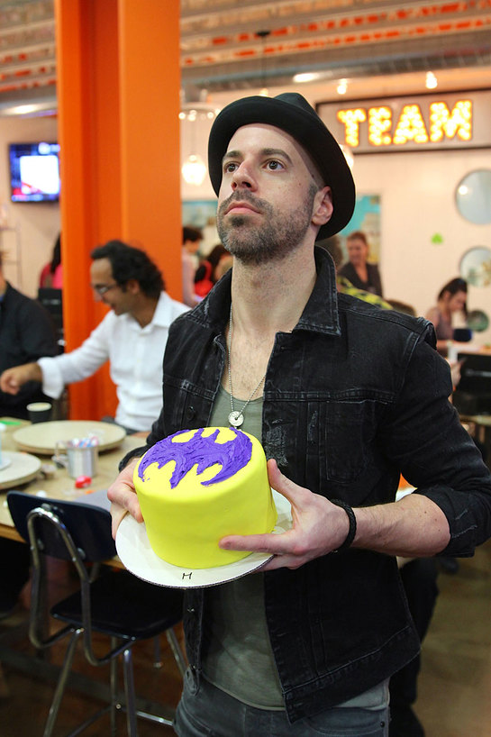 Chris Daughtry with a Batman cake that he decorated