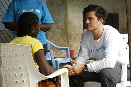Orlando Bloom meets with Sophia Vaye, a single mother, in the rented house where she and her five children live, in Tubmanburg in Bomi County