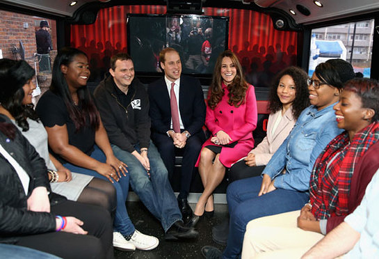 The Duke and Duchess of Cambridge with young people on the top deck of the XLP Mobile recording Studio