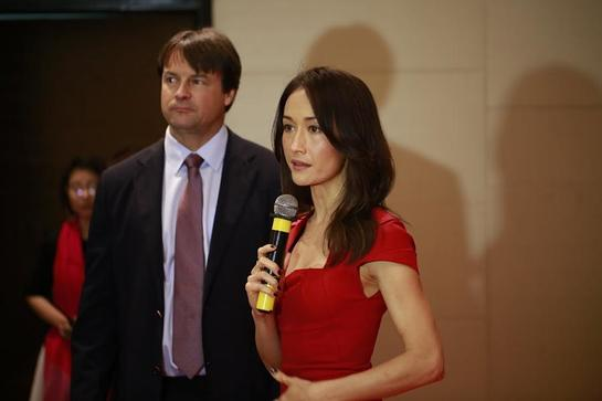 WildAid managing director John Baker and Maggie Q at the Stop Using Rhino Horn event