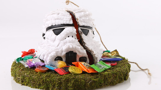 Bid on a selection of plaster stormtrooper helmet replicas uniquely decorated by artists around the world