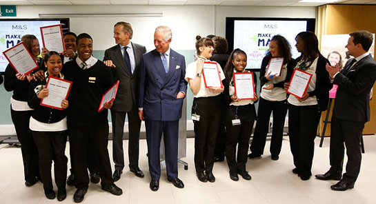 Prince of Wales with CEO of Marks and Spencer, Marc Bolland, and newly employed Prince's Trust 'Make your Mark' participants