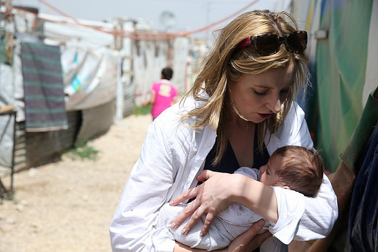 Laura cradles two-month-old baby born in Houch El-Oumara
