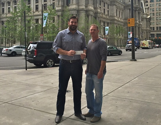 Todd Herremans Presents Check To Adopt A Pig