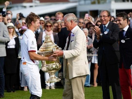 Prince Charles, Prince of Wales awards The Royal Salute Coronation Cup to James Beim of England