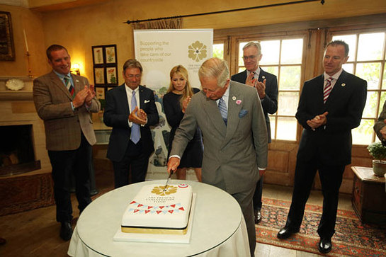 Prince Charles cuts a cake to mark the 5th anniversary of The Prince's Countryside Fund