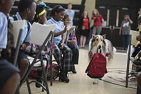 Lassie Carries a Disaster Supply Kit into a Save the Children Prep Rally, Treme Community Center, New Orleans