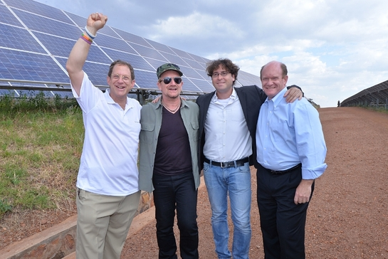 Bono with Gigawatt Global co-founders Yosef Abramowitz and Chaim Motzen, plus Chris Coons at East Africa's first solar field near Kigali, Rwanda