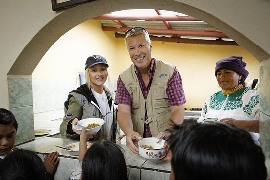 Christina Aguilera and Jonathan Blum, Chief Public Affairs Officer of Yum! Brands, serve food to children in Ecuador through the United Nations World Food Programme's school feeding program