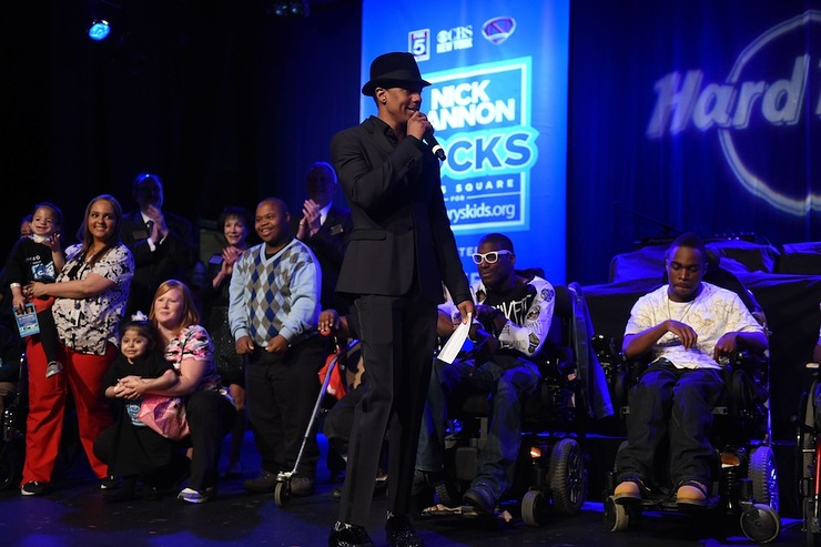 Nick Cannon onstage with St. Mary's kids