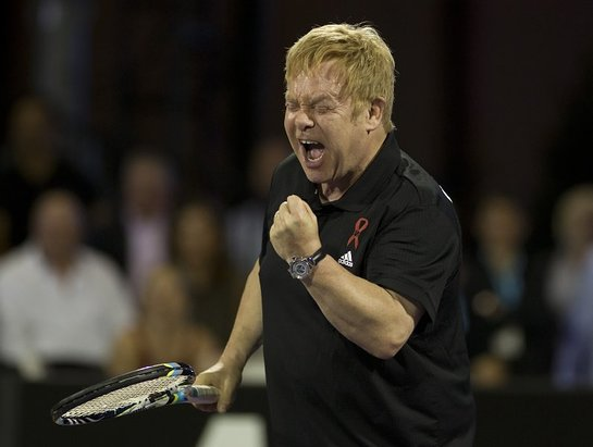 Elton John is fired up in the opening set of celebrity doubles.