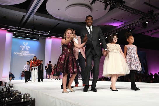 Jamie Foxx and his daughter, Annalise, escort models with Down syndrome on the catwalk.